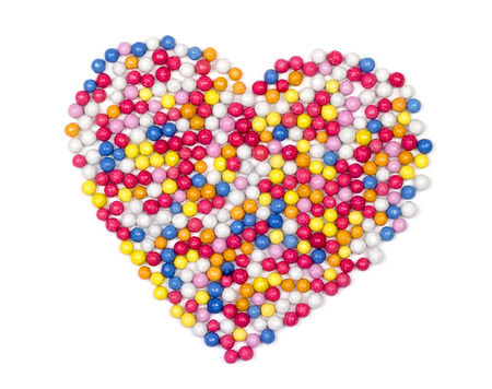 candy background: Colorful candy heart, sugar sprinkle dots