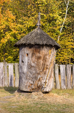ancient tradition: Wooden old ancient, tradition beehive, made from a tree trunk