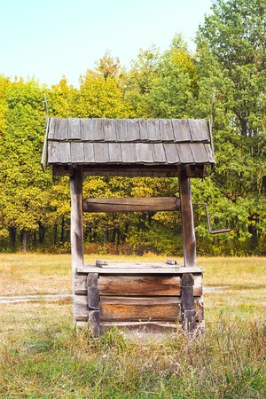 ancient tradition: Wooden old ancient, tradition Water Well, made from a tree trunk