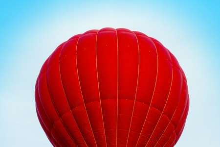Red hot air ballon in the blue sky, close-up