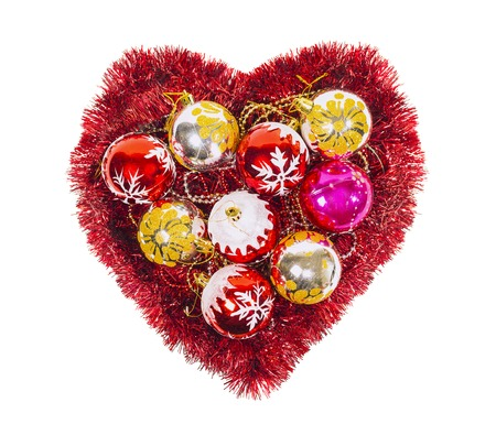 frippery: Christmas heart with red tinsel, balls, new year decoration isolated on white background
