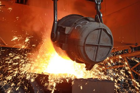 red-hot molten steel in a iron and steel enterprise production scene photo