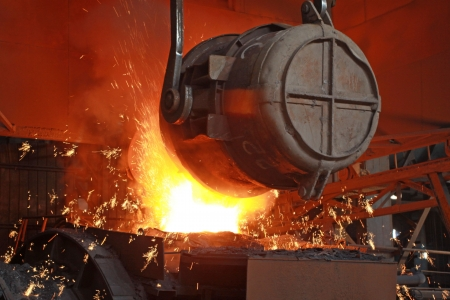 red-hot molten steel in a iron and steel enterprise production scene Stock Photo