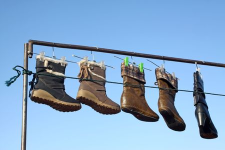 womens boots hanging in the air photo