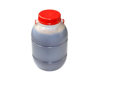 plastic bottles on a white background, with a red cap, can store liquid or liquid. Stock Photo - 7239940