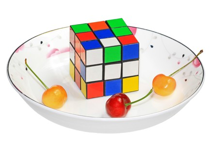 species plate: colorful cube on a white background, a very well-known puzzle game toys. Stock Photo