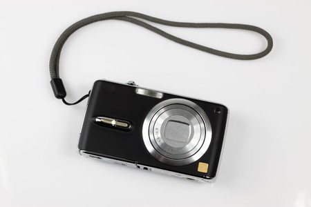 compact: digital camera on a white background. Stock Photo