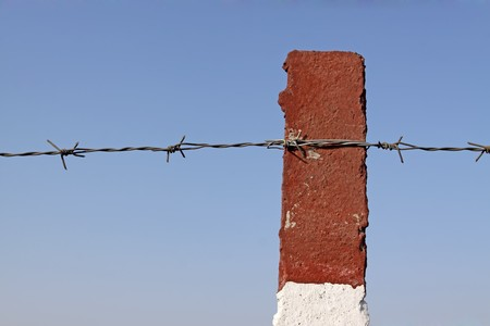 cement pile: barbed wire under the blue sky, Hebei, China.
