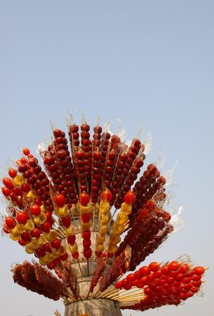 closeup of sugar-coated haws, in the blue sky. photo