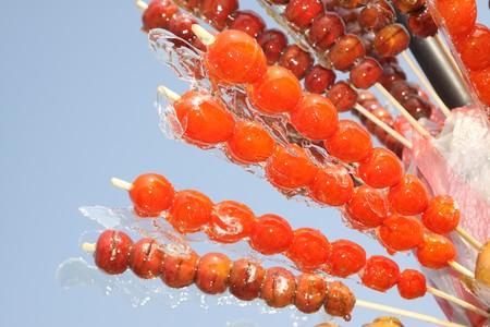 closeup of sugar-coated haws, in the blue sky. Stock Photo - 7397538