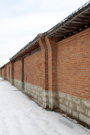 red brick repetition: long walls, creative picture of rural, north china.