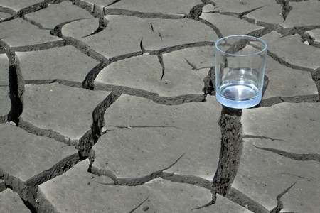 a transparent glass in the dry land, close-up, dry to the extreme, calling people to conserve water, protect the environment, Tangshan City, Hebei Province, China.   photo