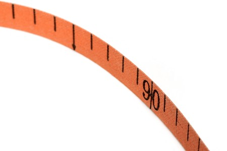 tape measure on a white background, close up of still life. photo