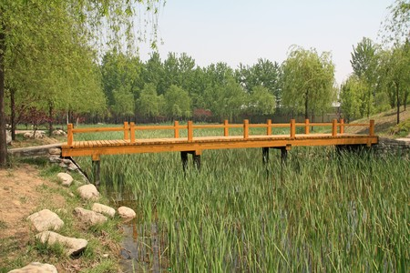 wood bridge in a park in spring, TangShang, HeBei, North China.