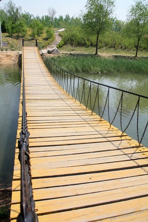 north china: wood bridge in a park in spring, TangShang, HeBei, North China.