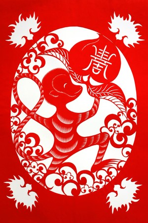 chinese paper-cut works in simple color background Stock Photo - 7457258