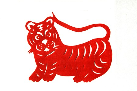 chinese paper-cut works in simple color background photo