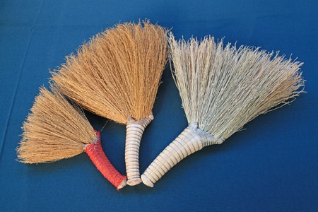 agricultural implements: small brooms in blue background