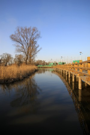 wood bridge in a park, TangShang, HeBei, North China. Stock Photo - 7474803