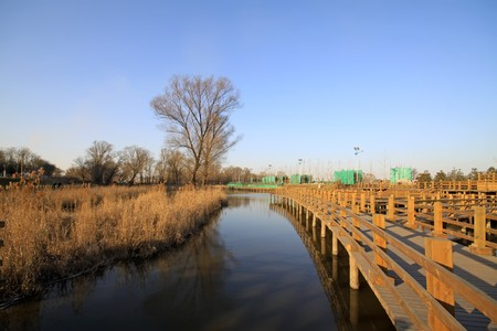 wood bridge in a park, TangShang, HeBei, North China. Stock Photo - 7475025