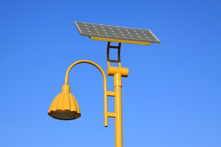 yellow solar street light use of natural resources, in the blue sky, Tangshan City, Hebei Province, china.  photo