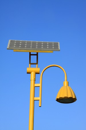 outdoor lighting: yellow solar street light use of natural resources, in the blue sky, Tangshan City, Hebei Province, china.