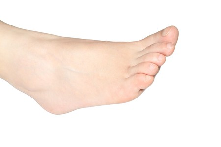 young womens foot on a white background photo