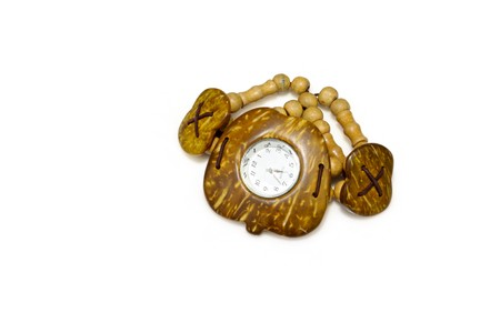 embedding: close up of coconut shell watch on a white background.