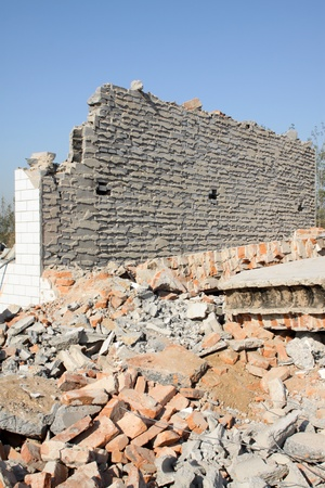 demolition of smoldering rubble in chinas rural  photo