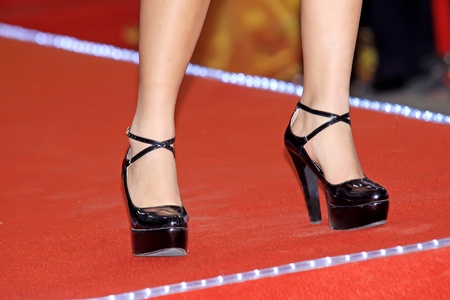 crus: pair of female legs wearing high heeled shoes Stock Photo