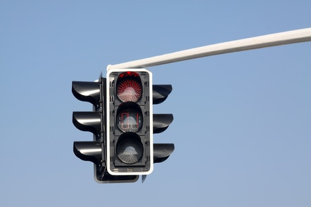 the traffic signal lights in the blue sky photo