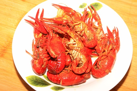 aquatic products: close up of cooked crayfish on a plate.