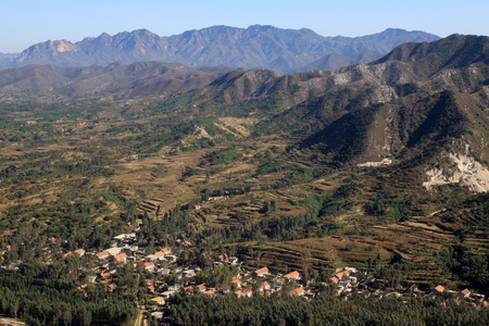 villages and dwellings at the foot of the mountain photo