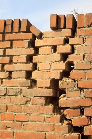 there is crack of red brick wall Banco de Imagens