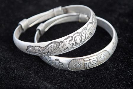 closeup of silver bracelet, a kind of female jewelry  photo