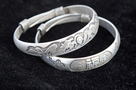 closeup of silver bracelet, a kind of female jewelry  photo