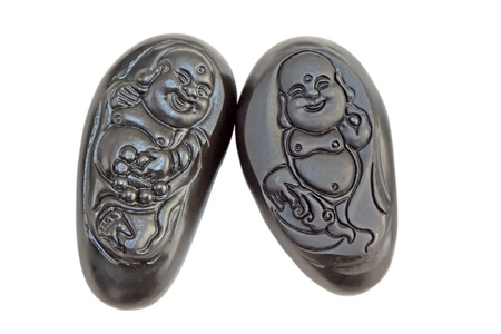 closeup of black jade carving works on a white background photo