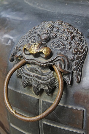 lion head on a chinese copper censer surface