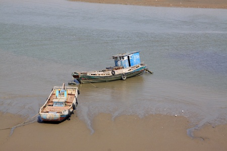 pat down: fishing boats sailing in the water in northern china Stock Photo
