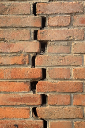 closeup of pictures, crack of red brick wall photo