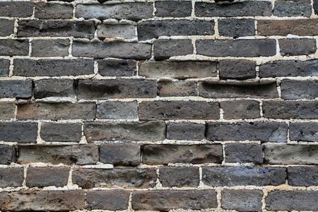muro rotto: primo piano di grigio muro rotto Archivio Fotografico