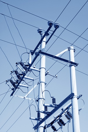 crisscross: electric power supply pole mixed and disorderly crisscross the blue sky