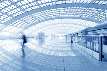 capacious: Beijing capital international airport passenger train and tourists  Editorial