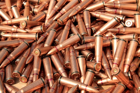 warheads: closeup of pictures, piles of rifle bullets