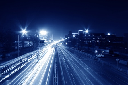 light trails on the modern street at night in beijing\ financial center,China