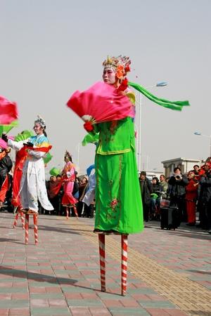 stilts: yangko, a popular rural folk dance in china