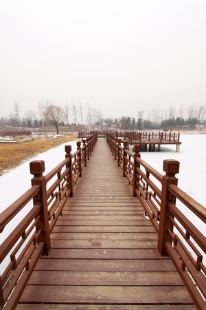 winter range: Chinese traditional style wooden bridge in a park