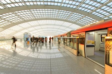 Beijing capital international airport passenger train and tourists  Editorial