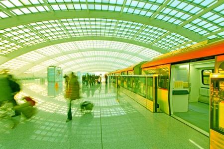 Beijing capital international airport passenger train and tourists  Stock Photo - 12779054