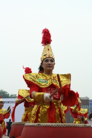 ornate women beat drums shows in north china Stock Photo - 13022053